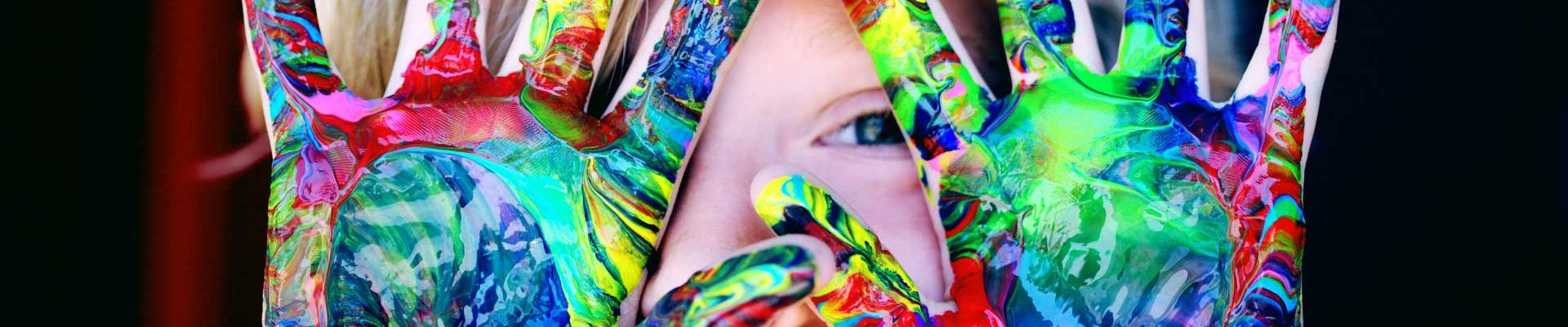 Girl with painted hand close up
